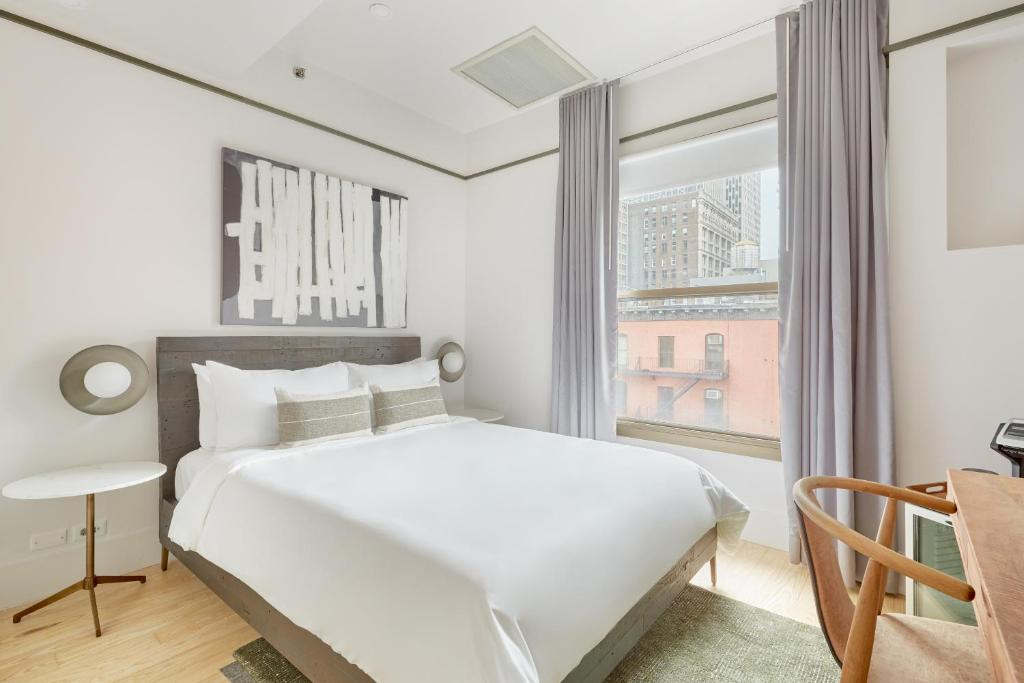 A bed or beds in a room at Sonder l Duane Street