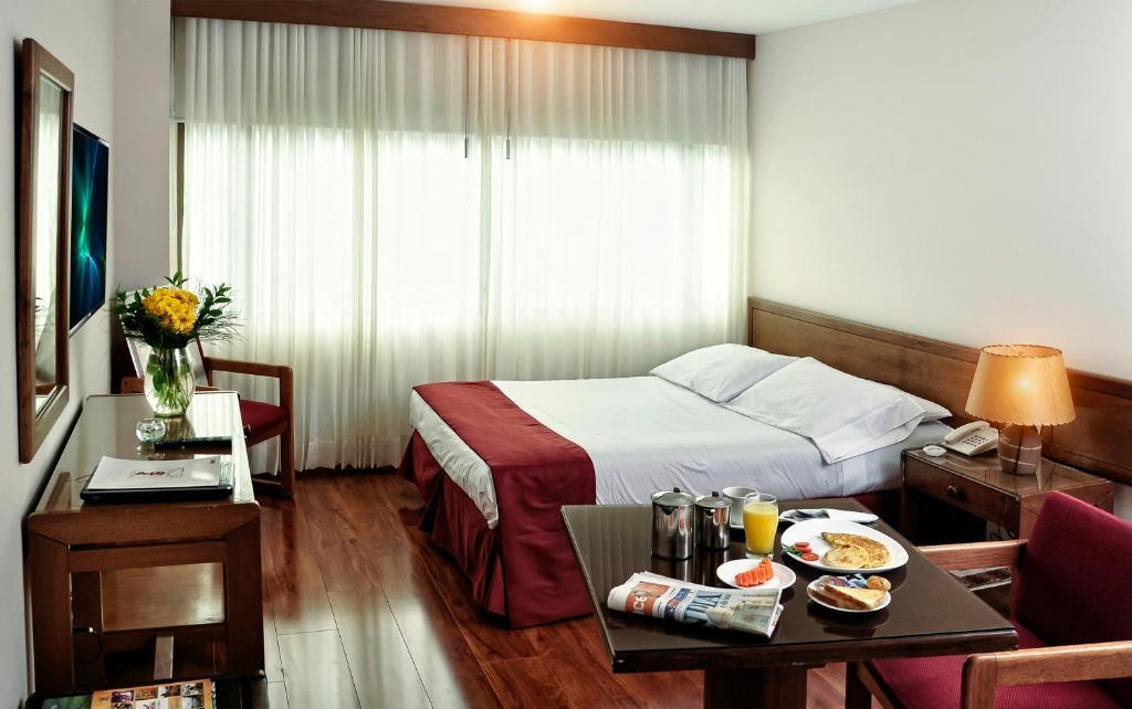 Cama o camas de una habitación en Hotel Boyaca Plaza