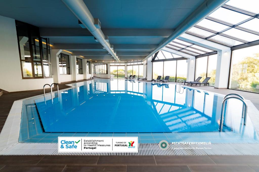 The swimming pool at or near Meliá Castelo Branco