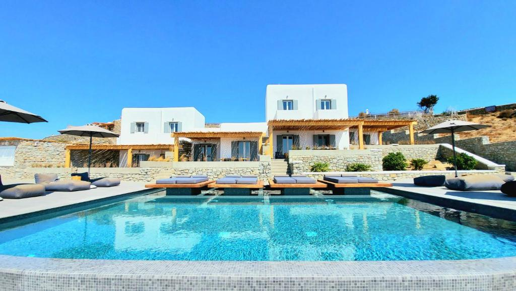 The swimming pool at or near Privilege houses Mykonos by villa evi
