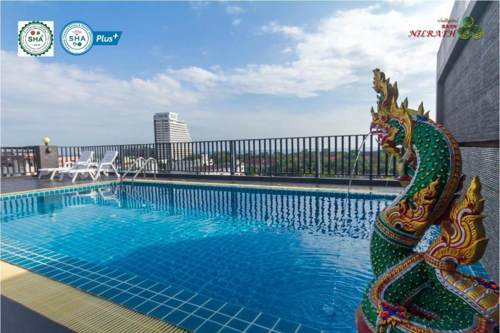 The swimming pool at or near Baan Nilrath Hotel