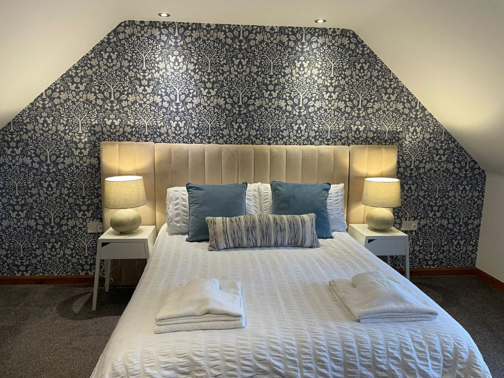 A bed or beds in a room at The Square Kintore