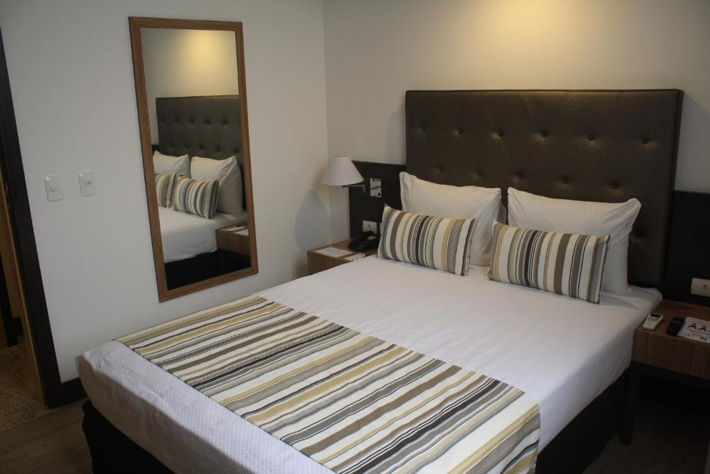 A bed or beds in a room at Residencial Budget