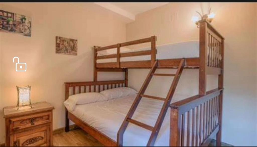 A bunk bed or bunk beds in a room at Habitación caleta
