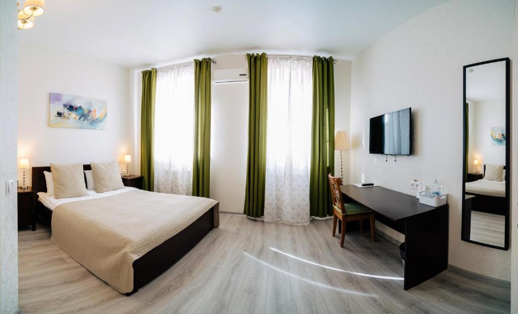 Кровать или кровати в номере Гостиница Вилла роща