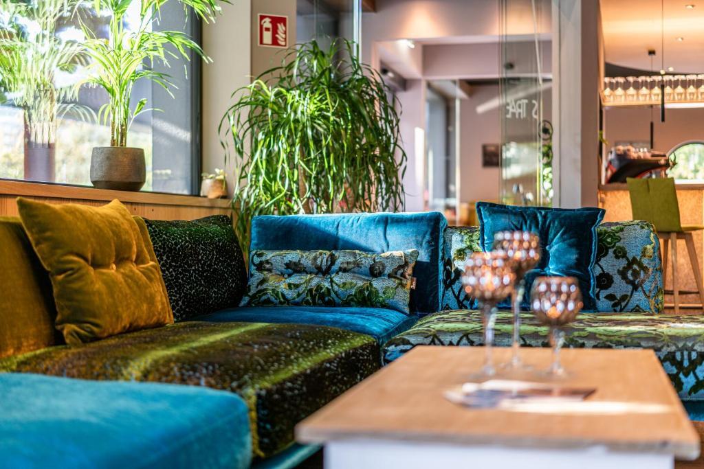 Ein Sitzbereich in der Unterkunft Rufi's Hotel & Apartments