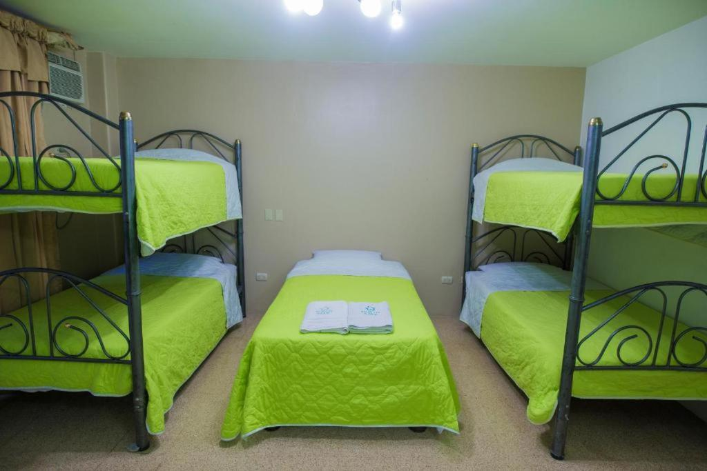 A bunk bed or bunk beds in a room at North Star Hostal Guayaquil