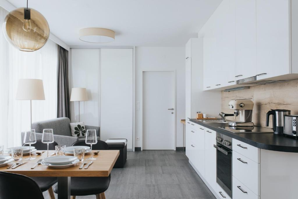 A kitchen or kitchenette at Parks 73 The Townhouse Hotel