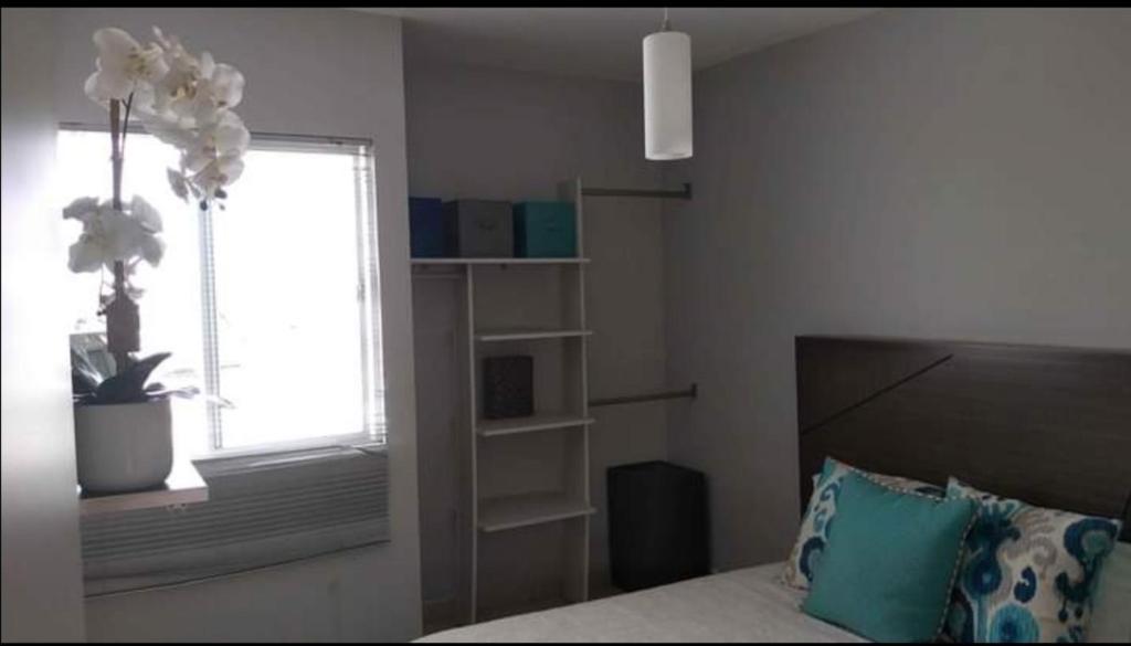 Cama o camas de una habitación en Habitaciones Matamoros