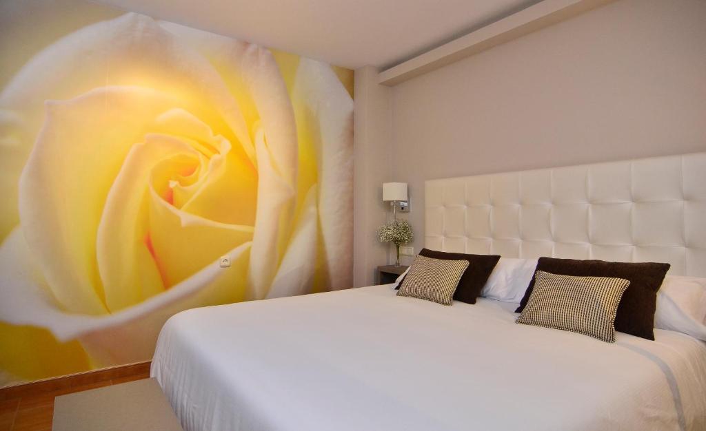 Cama o camas de una habitación en Hotel Jucamar