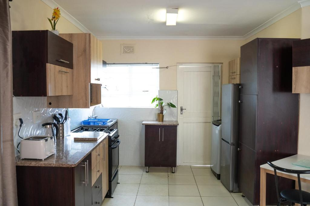 A kitchen or kitchenette at DEI GRATIA GUESTHOUSE