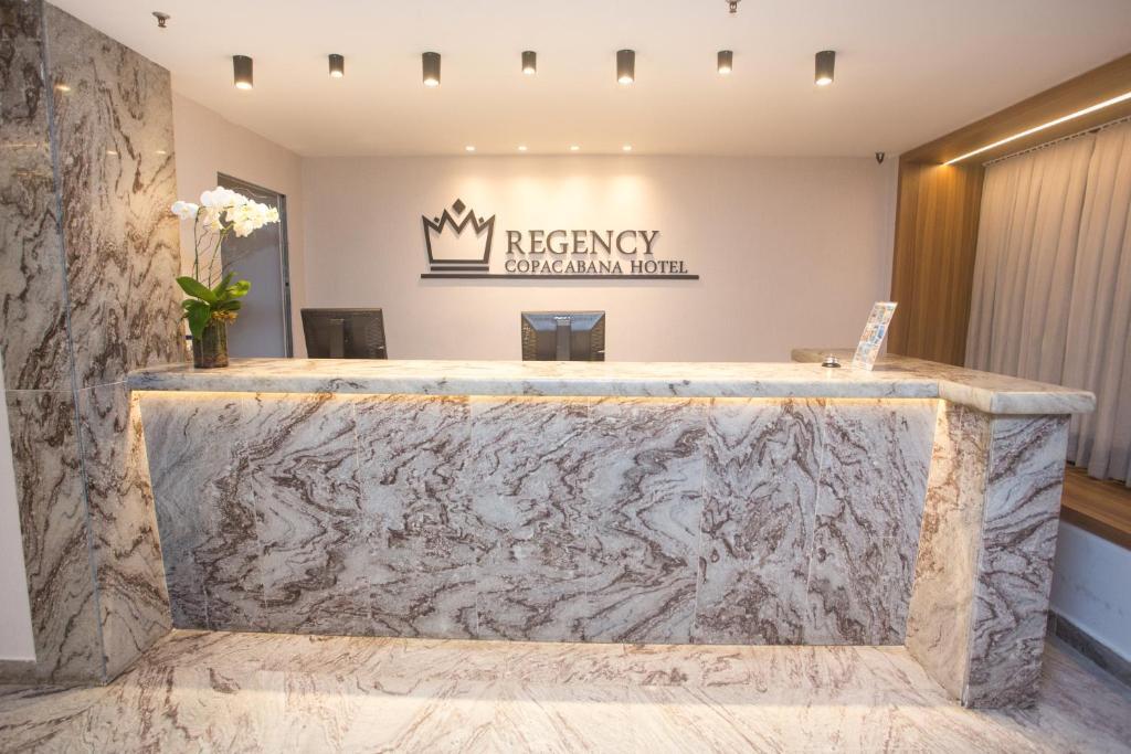The lobby or reception area at Regency Copacabana Hotel