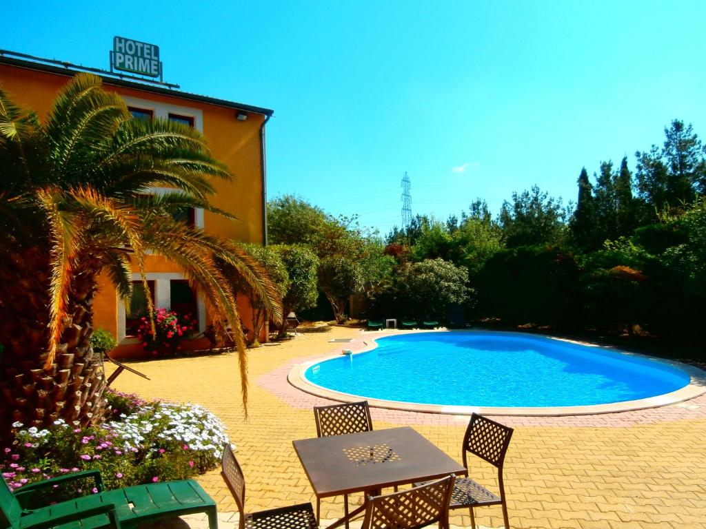 The swimming pool at or close to Logis Hotel Prime - A709