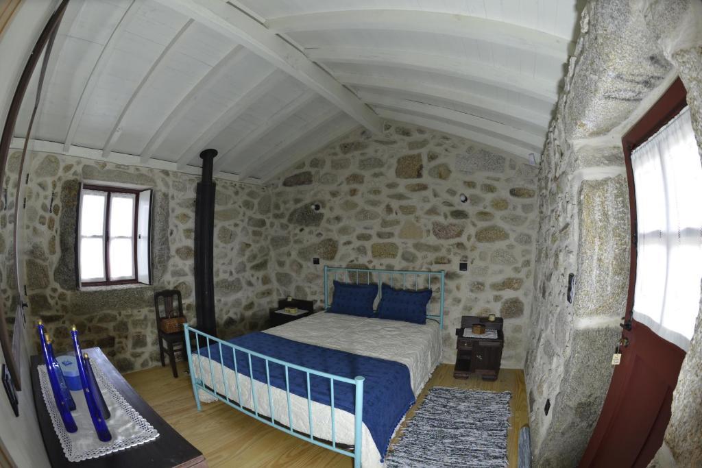 Uma cama ou camas num quarto em Traços de Outrora Casa da Matilde