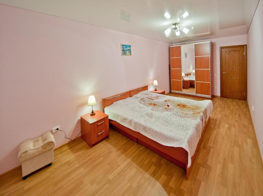 Кровать или кровати в номере Piterstay on Mayakovskaya