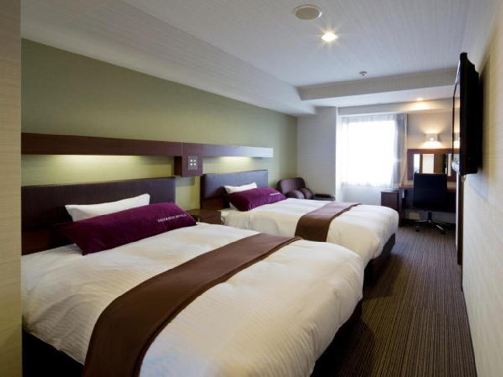 Tempat tidur dalam kamar di Green Rich Hotel Kyoto Station South (Artificial hot spring Futamata Yunohana)