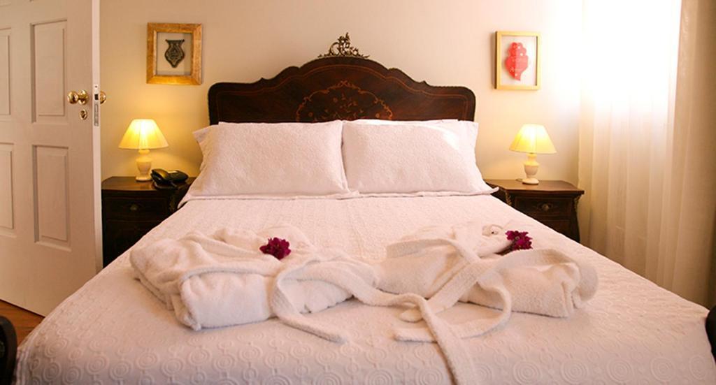 Uma cama ou camas num quarto em Casa Manuel Espregueira e Oliveira