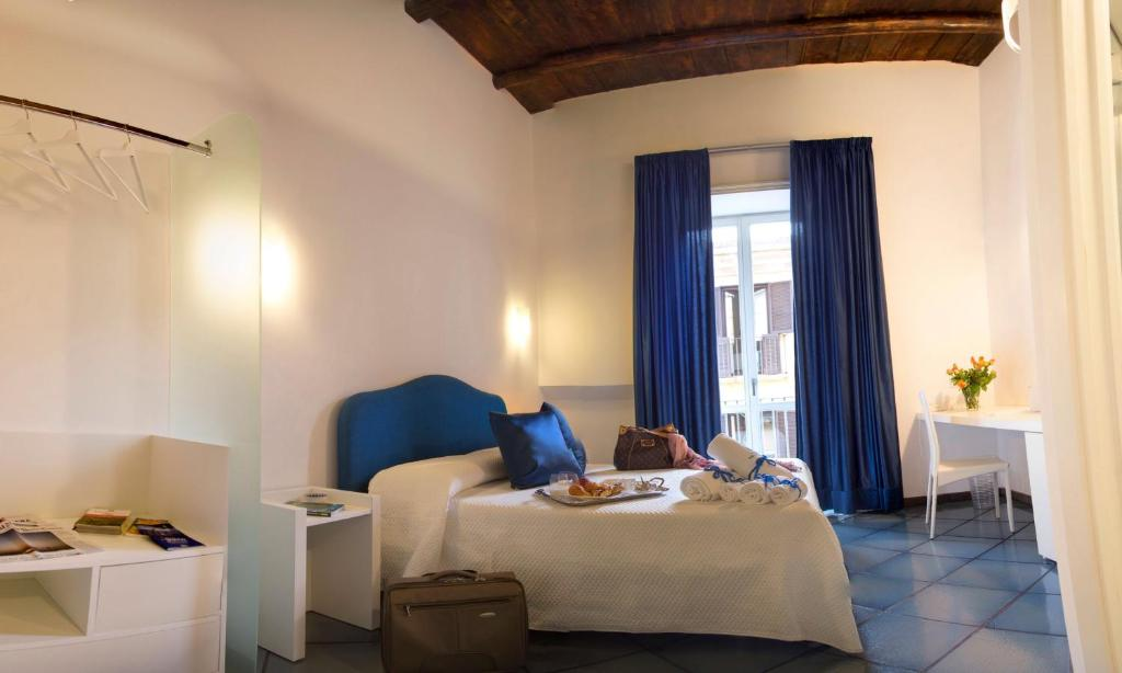 A bed or beds in a room at Dimora Salerno