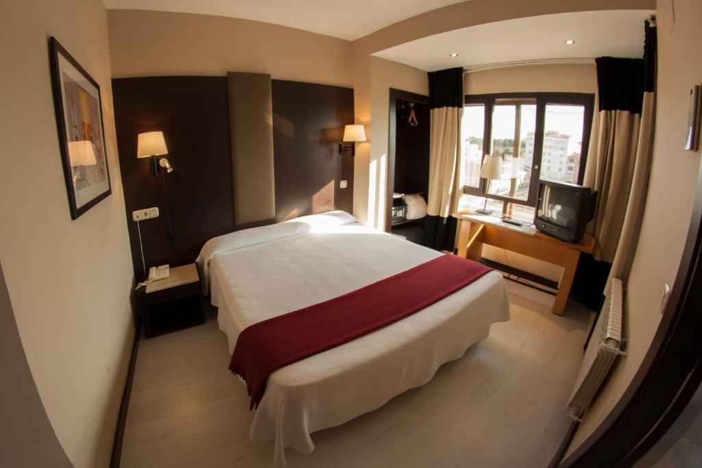 Cama o camas de una habitación en Hotel Delta