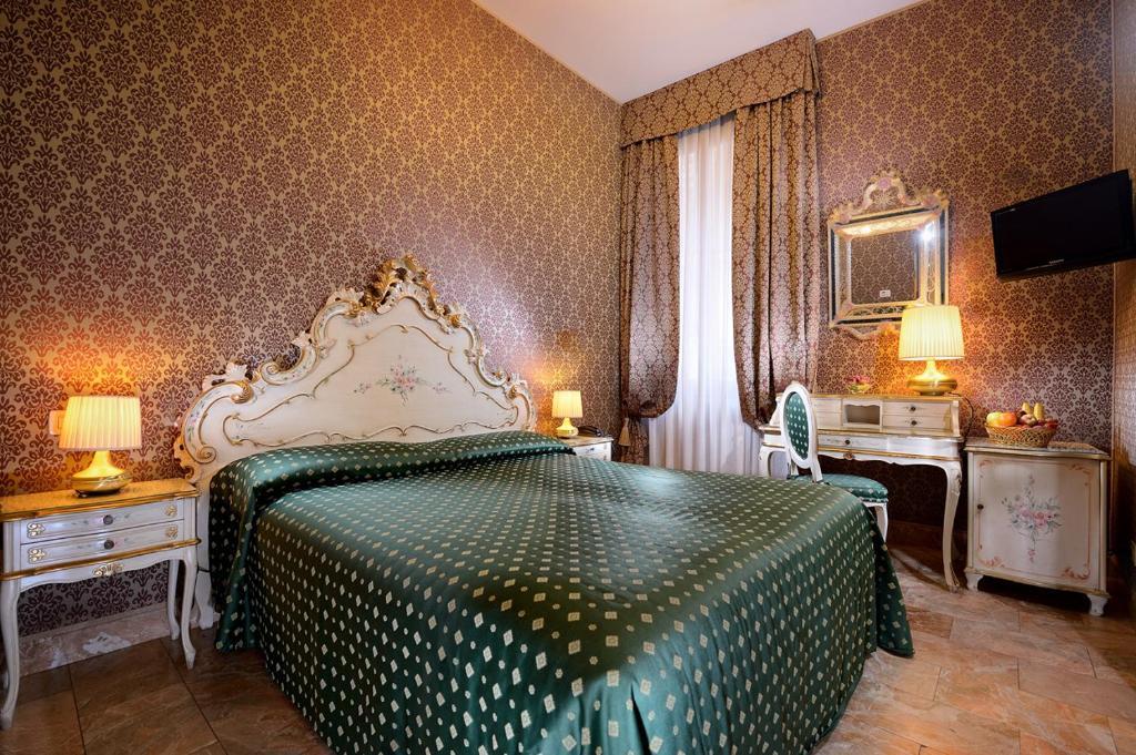 Cama ou camas em um quarto em Hotel Canaletto
