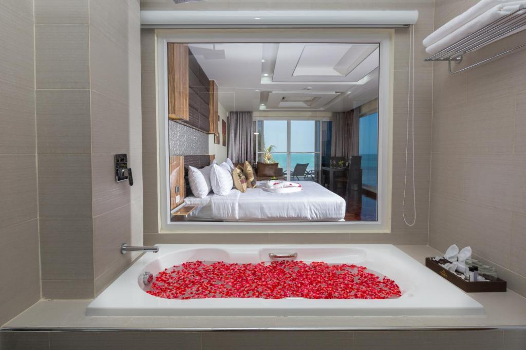 A bathroom at Royal Beach Boutique Resort & Spa Koh Samui - SHA Plus