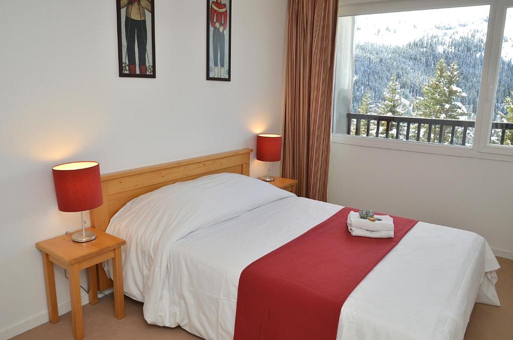 Een bed of bedden in een kamer bij Residence les Pleiades