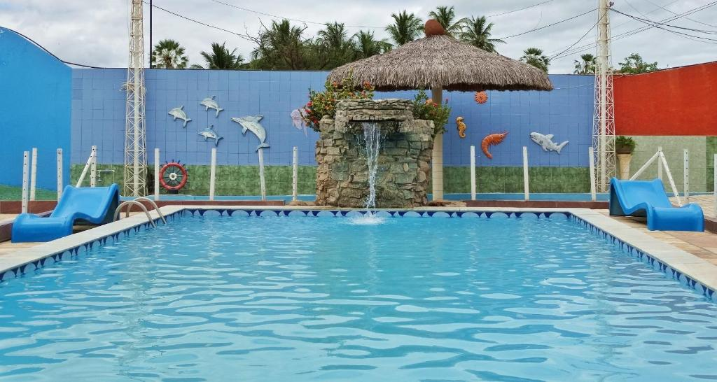 The swimming pool at or near Hotel Oásis