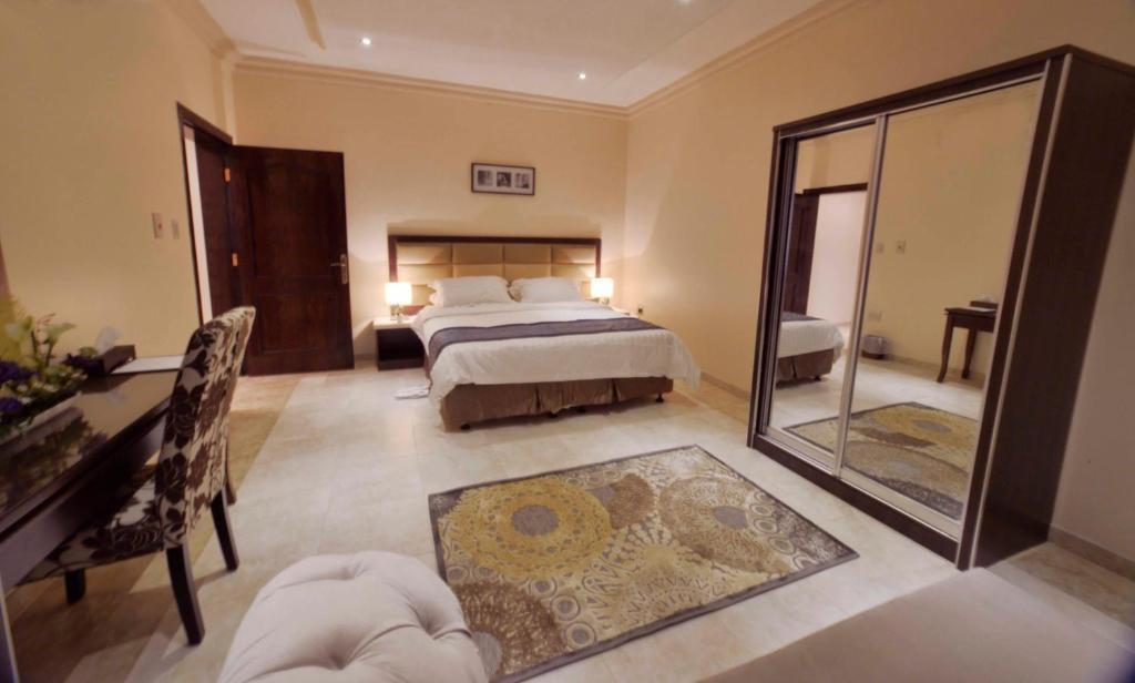Cama ou camas em um quarto em City Suites