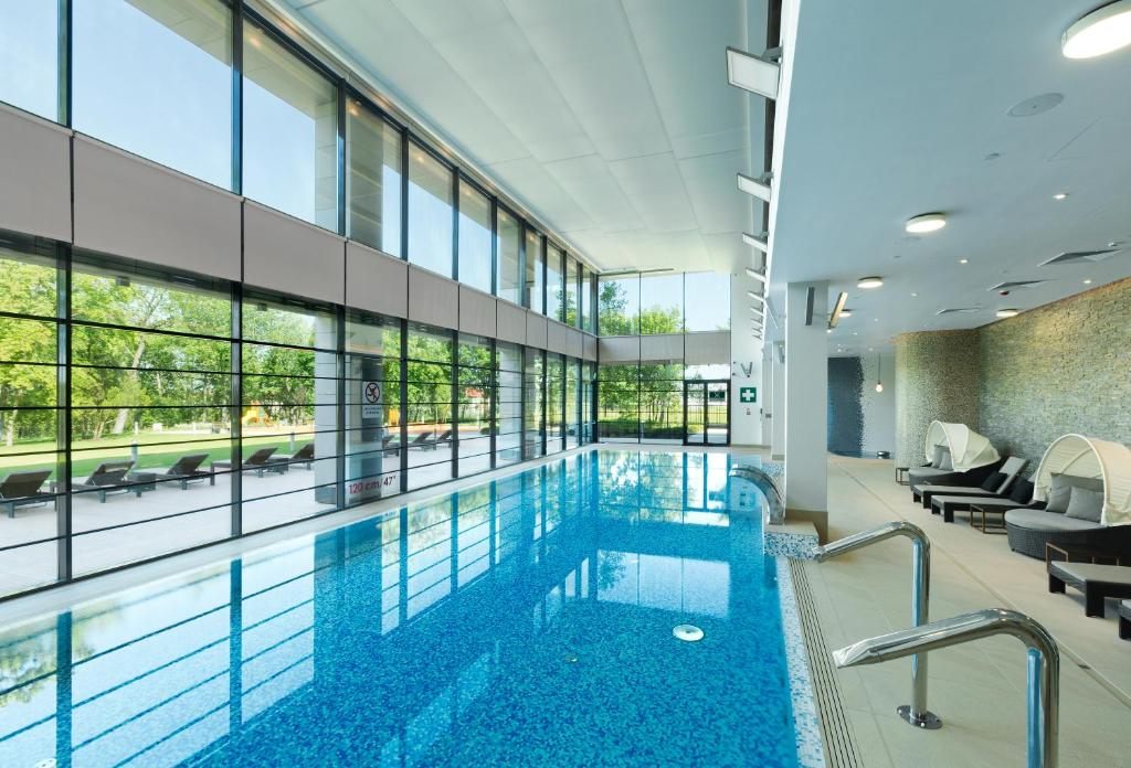 The swimming pool at or near DoubleTree by Hilton Hotel & Conference Centre Warsaw