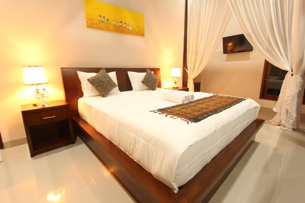 A bed or beds in a room at Mahanadewi Villa
