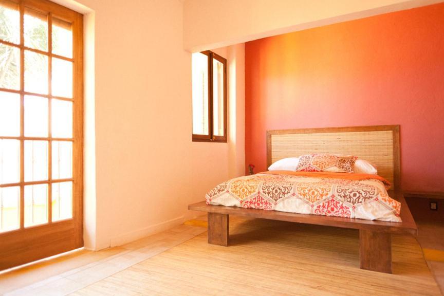 Cama o camas de una habitación en Hostal San Pancho