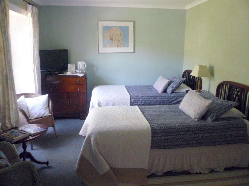 A bed or beds in a room at Woodburn House