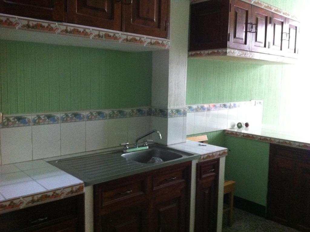 A kitchen or kitchenette at Hotel El Portal