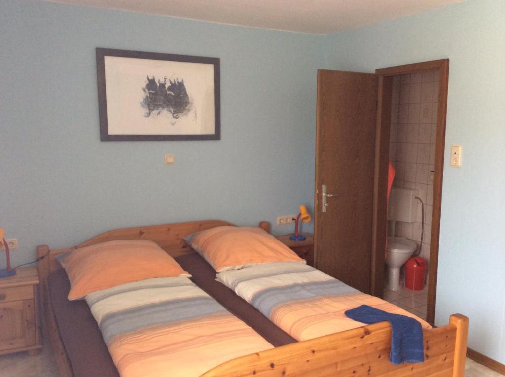 Ein Bett oder Betten in einem Zimmer der Unterkunft Pension Lippert