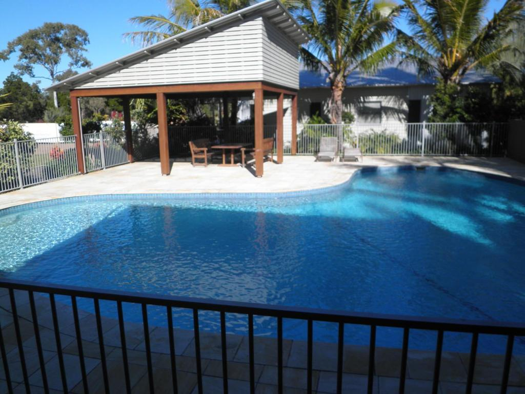The swimming pool at or near Woodgate Beach Houses