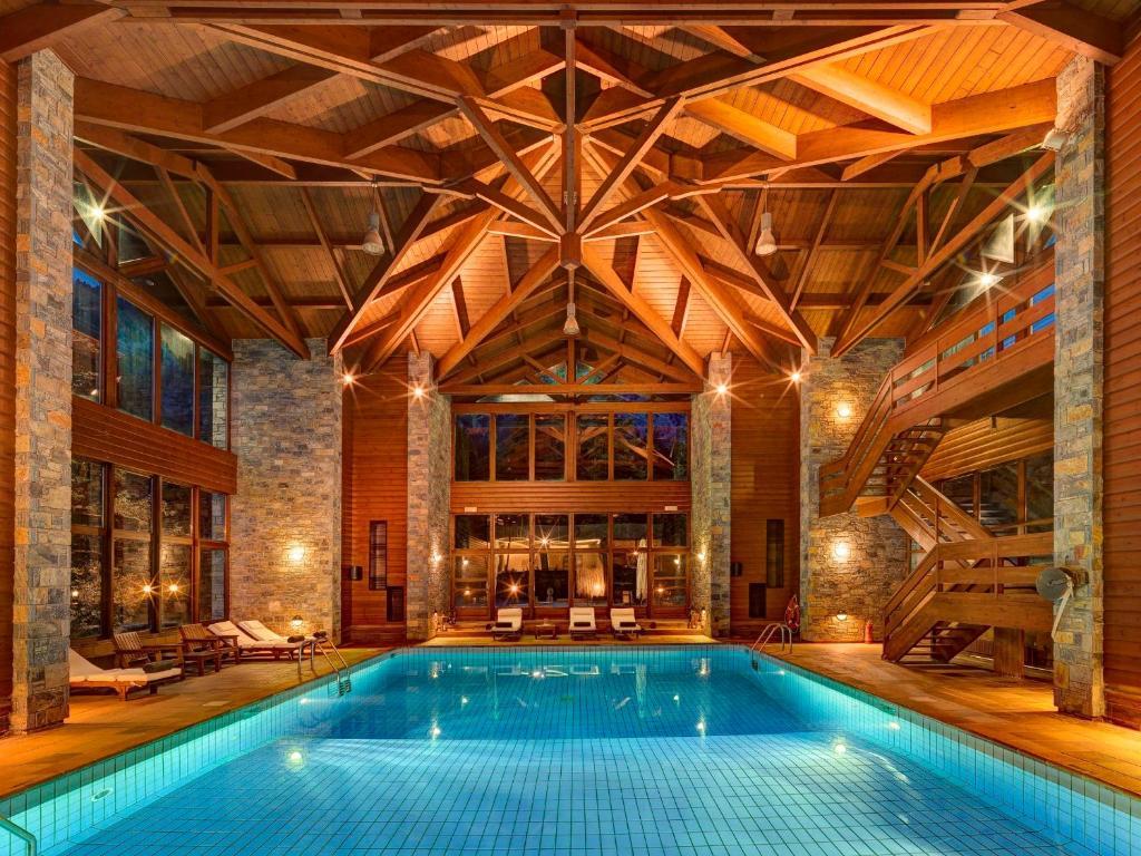 The swimming pool at or near Elatos Resort & Health Club