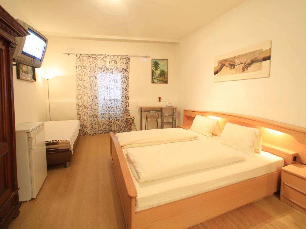 Postel nebo postele na pokoji v ubytování Bockwirt