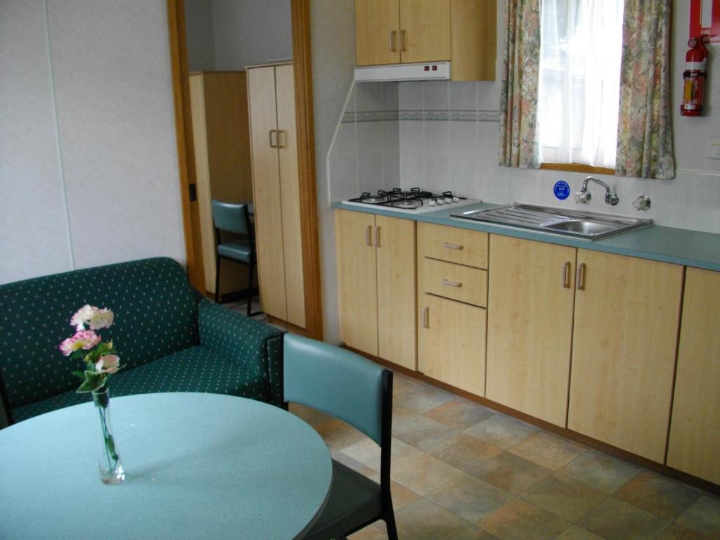 A kitchen or kitchenette at Prom Central Caravan Park
