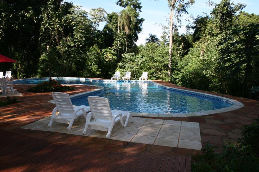 The swimming pool at or close to Cabañas Luces De La Selva