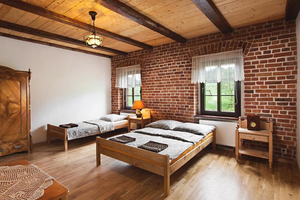 Łóżko lub łóżka w pokoju w obiekcie Agrohippika
