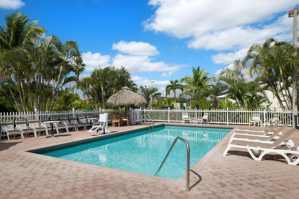 The swimming pool at or near Travelodge by Wyndham Florida City/Homestead/Everglades
