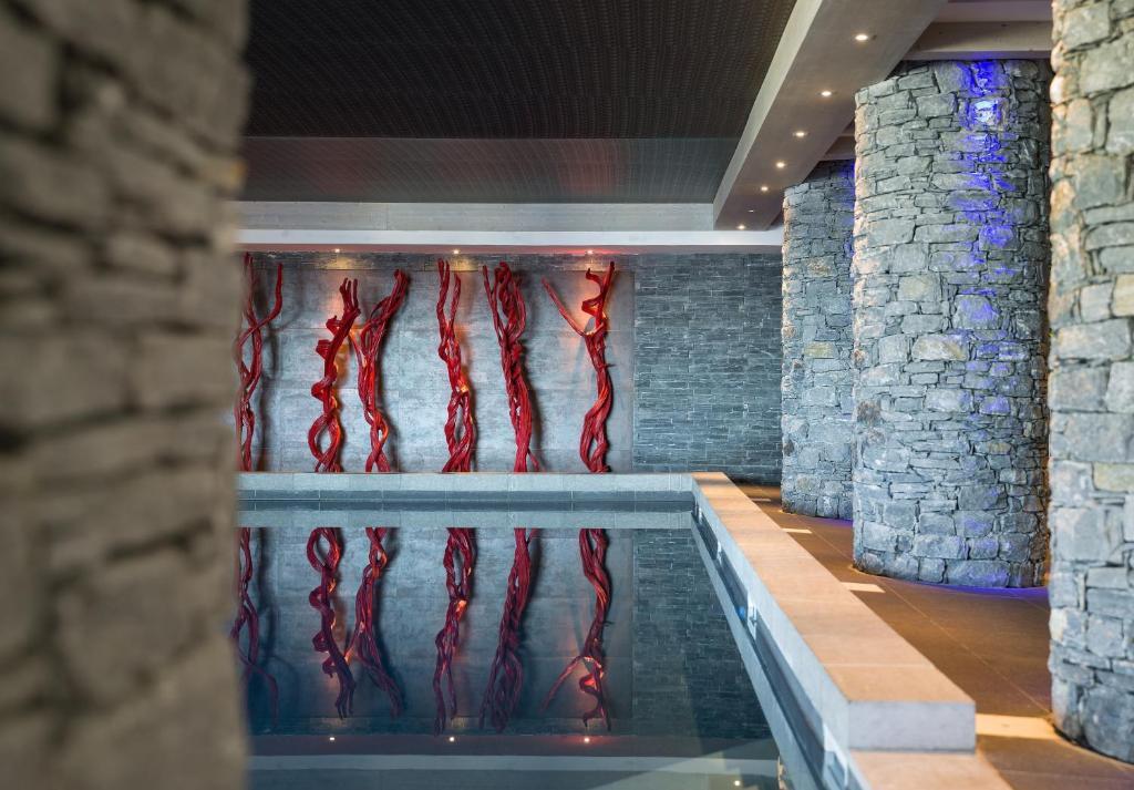 The swimming pool at or near CGH Résidences & Spas Le Lodge Hemera