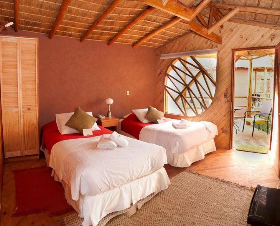 Cama o camas de una habitación en Hotel Poblado Kimal