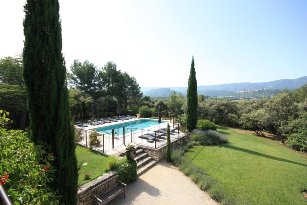 A view of the pool at La Bastide de Soubeyras or nearby
