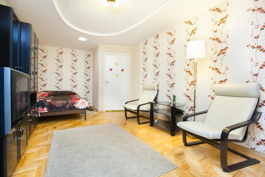 Гостиная зона в Standard Brusnika Apartment Kantemirovskaia