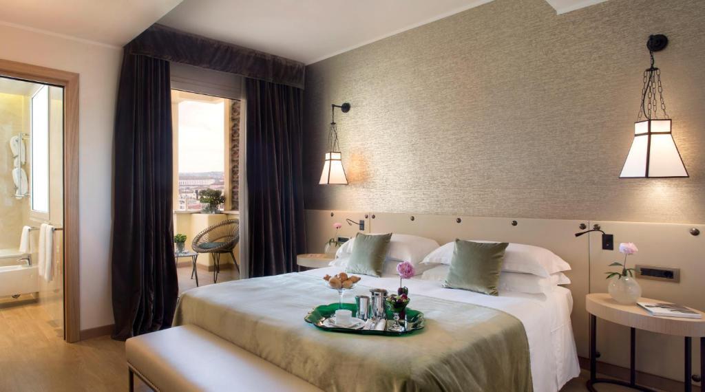 Ein Bett oder Betten in einem Zimmer der Unterkunft Starhotels Metropole