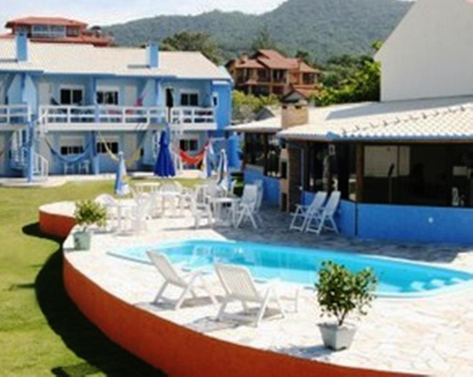 A piscina localizada em Pousada Praia da Villa ou nos arredores