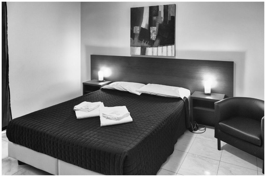 Ein Bett oder Betten in einem Zimmer der Unterkunft Hostel Mosaic
