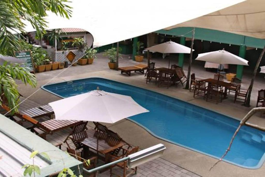 The swimming pool at or near Hideaway Hotel
