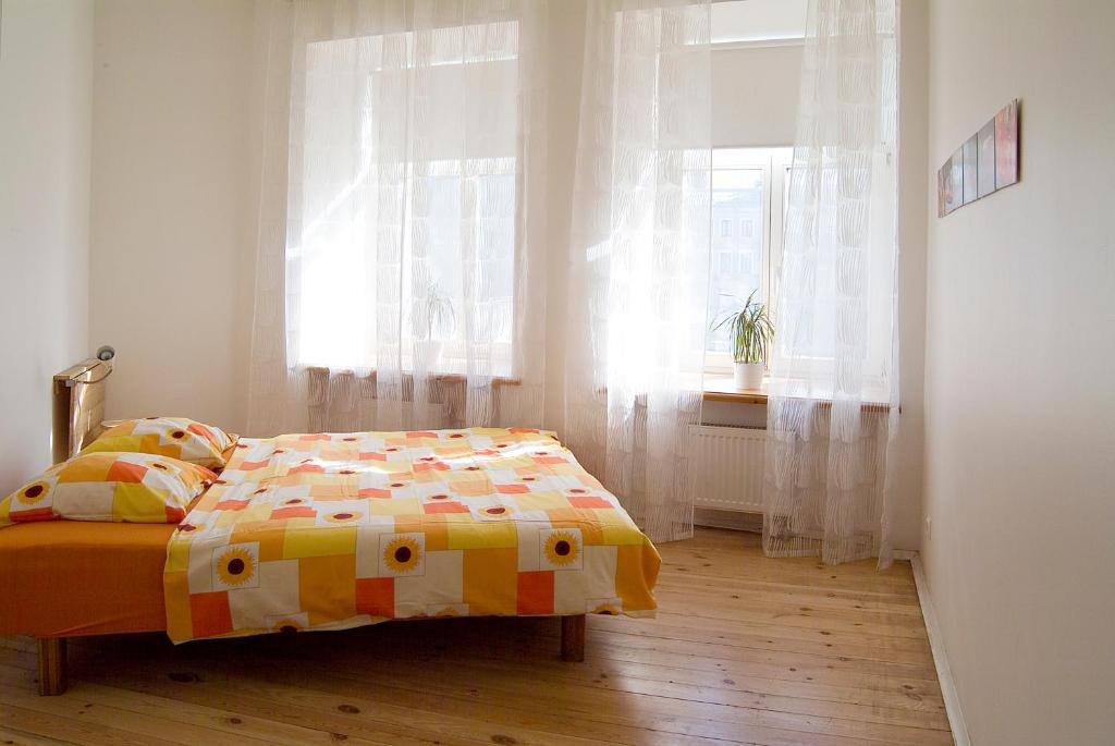 A bed or beds in a room at SwissSTAR